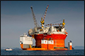 Dockwise Vanguard laadt vaartuig van 245 meter in Calandkanaal