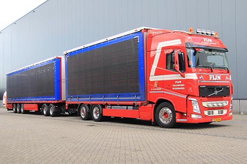 Van vlakke Kögel Trailer naar pluimveeopbouw naar LZV voor Fijn Int Transport B.V.
