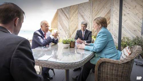 Merkel en Biden strijken plooien glad